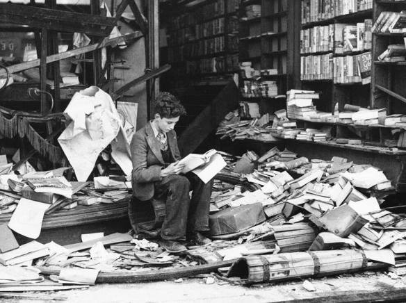 A Boy Reading in a Ruined Bookshop in London, After a Night of Heavy Bombing in October 1940